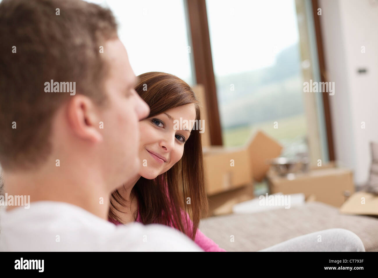 portrait of young woman in new flat - Stock Image