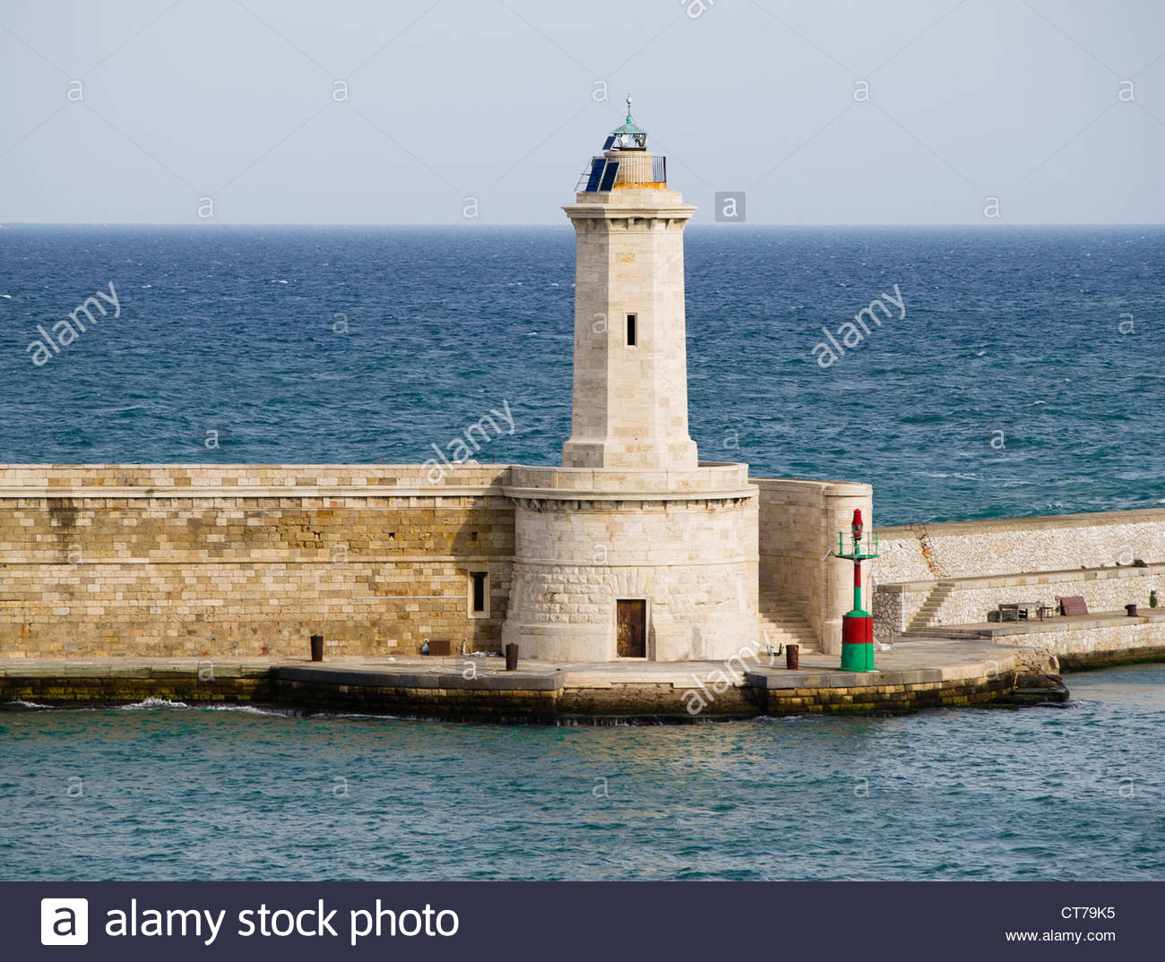 A lighthouse in a windy morning - Stock Image