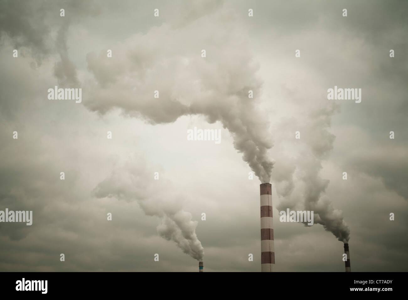 Industrial chimneys smoking - Stock Image