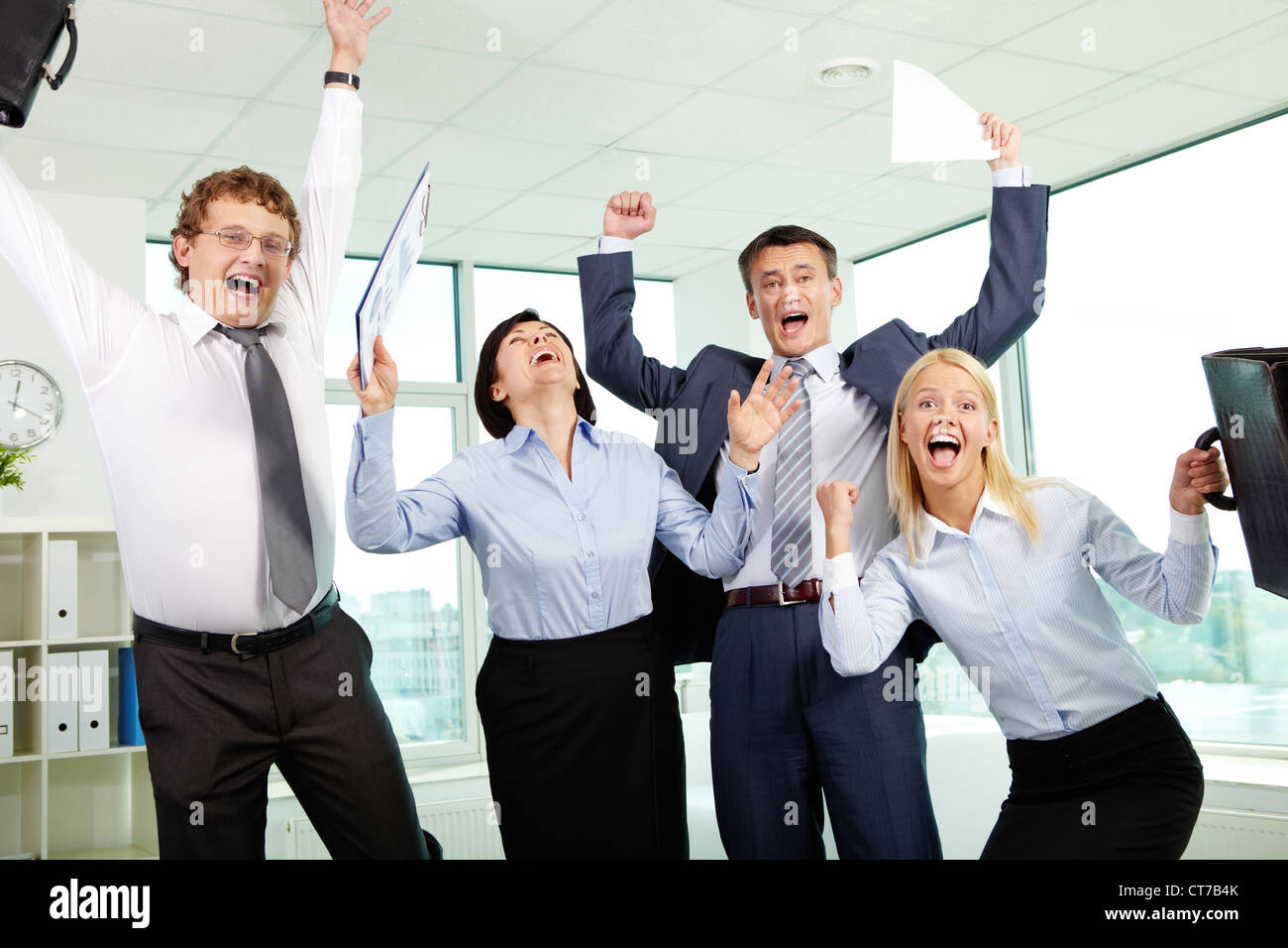 Group of emotional businesspeople showing their gladness - Stock Image