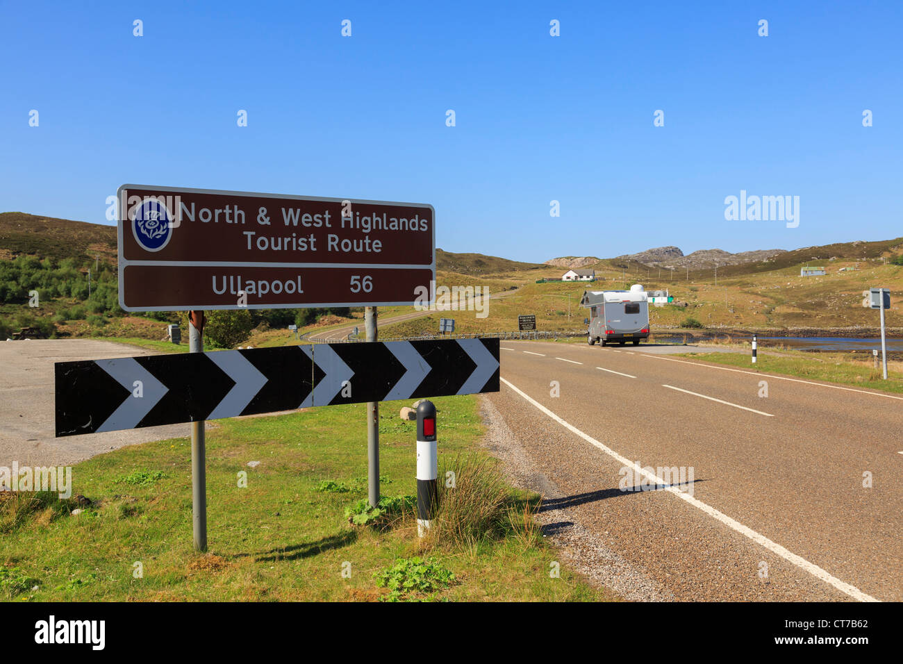 Sign by scenic country road on A838 North and West Highlands Tourist Route in summer Rhiconich Sutherland Highland - Stock Image