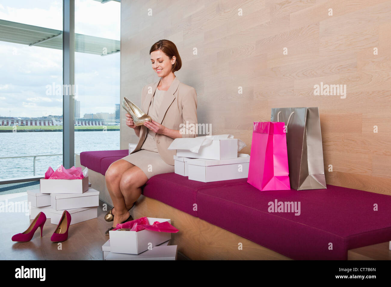 Woman trying on shoes in shoe shop Stock Photo