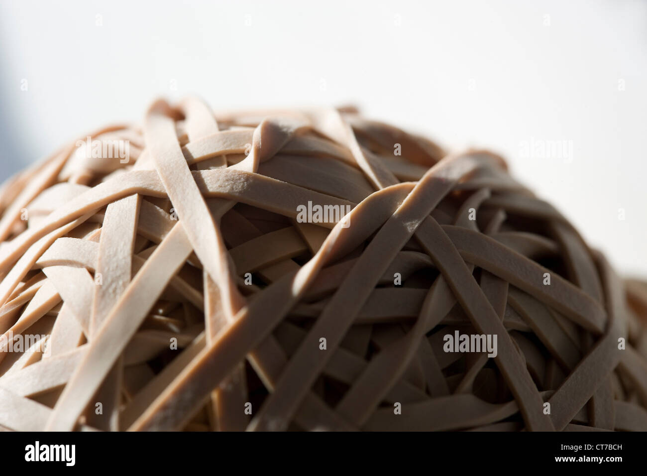 Ball of rubber bands - Stock Image