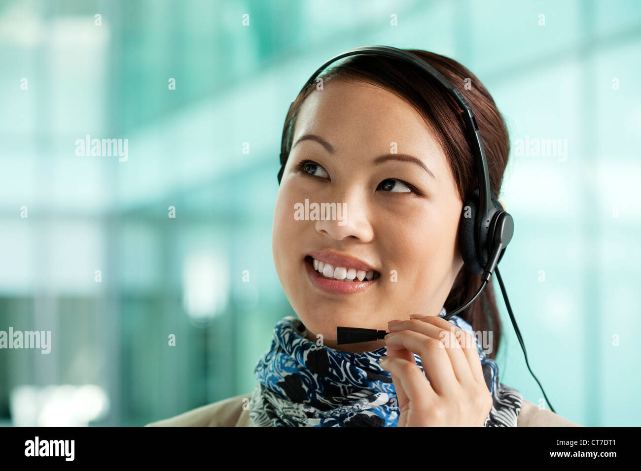 Office worker wearing headset - Stock Image