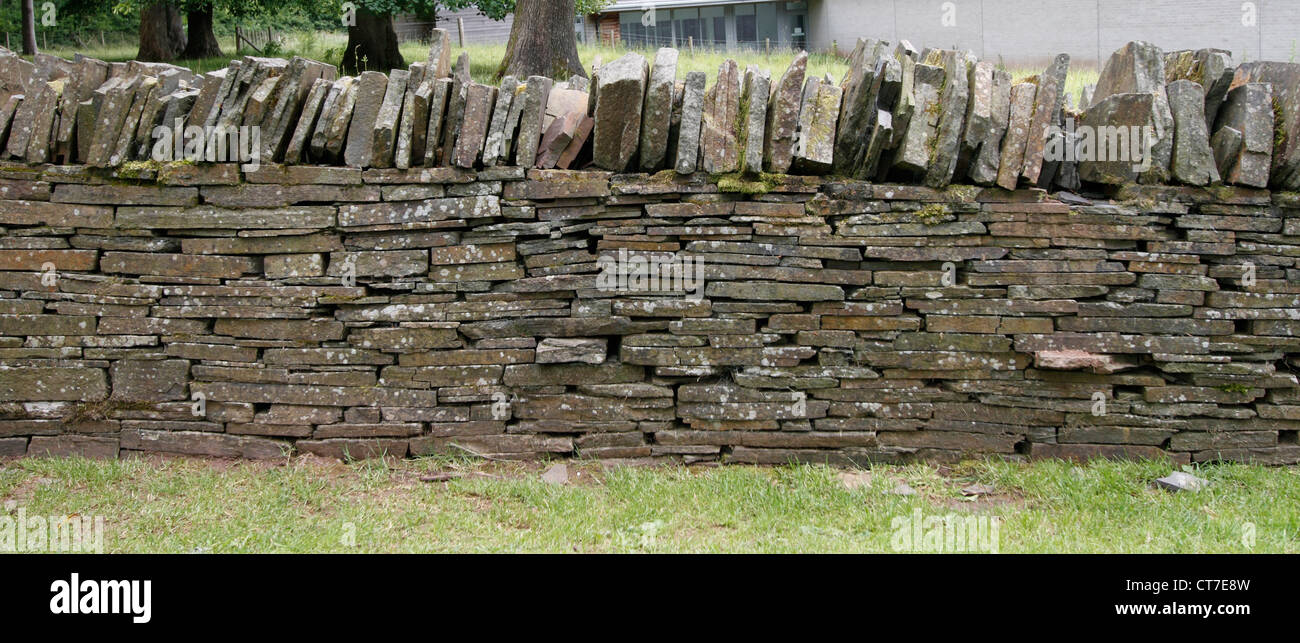 Dry Stone wall - Old red sandstone sourced from quarries at Penhow and Ewenny. The wall is typical of those found - Stock Image