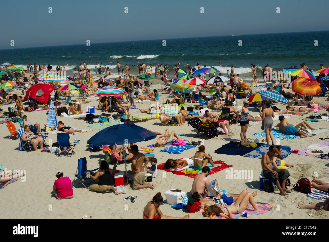 Beachgoers escape the heat wave at Rockaway Beach in the Queens borough of New York Stock Photo