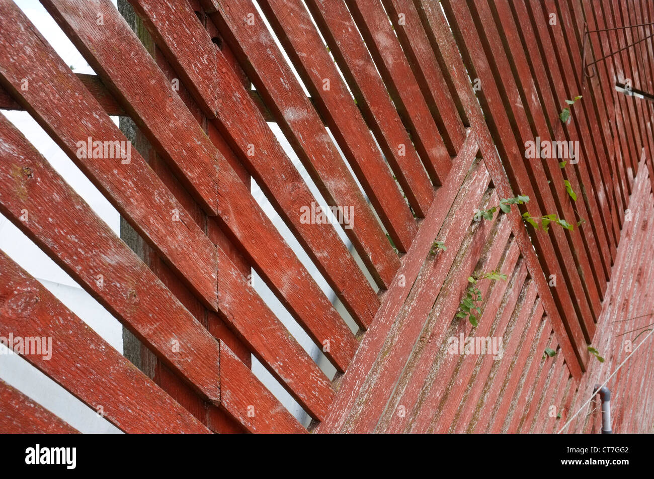 Cross hatched treated wooden fence - Close up detail. - Stock Image