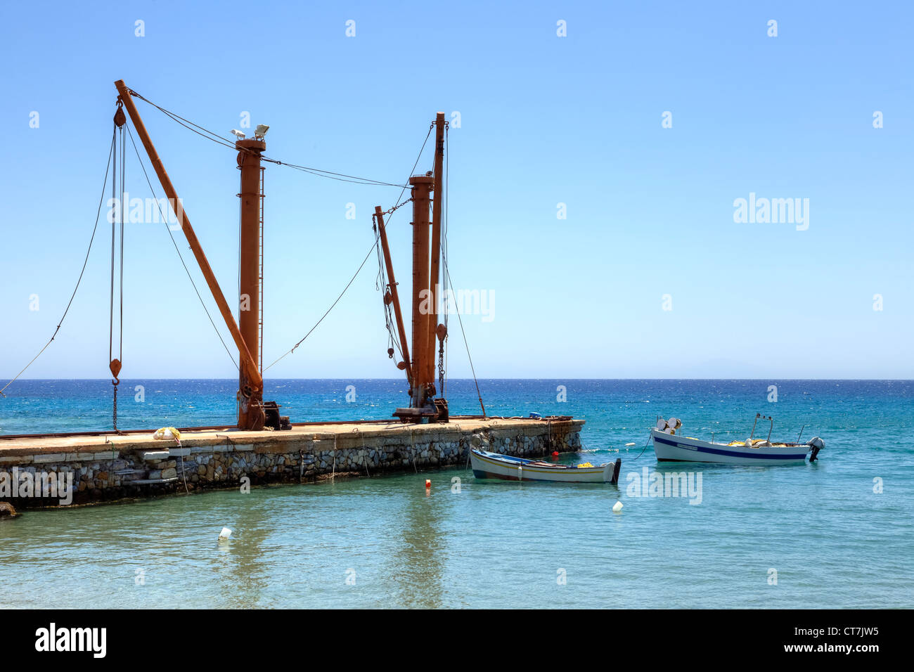 old loading cranes in the former mining port Moutsouna, Naxos, Greece - Stock Image