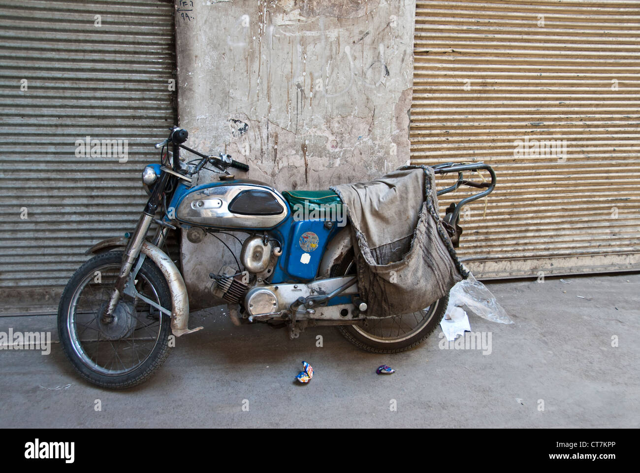 Old fashion Motorbike parked in the bazaar of Isfahan, Iran - Stock Image