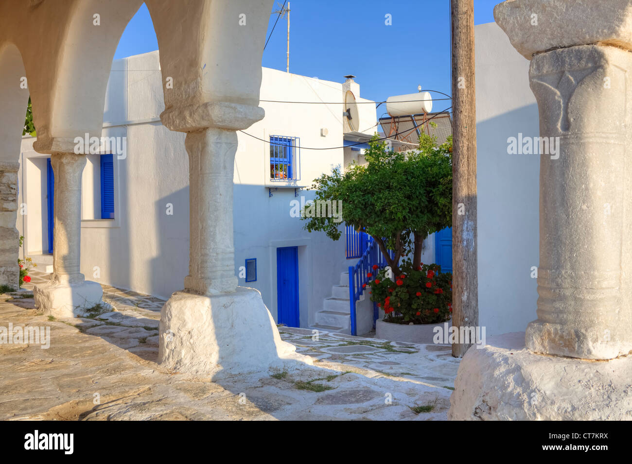 View through the pillars of the church of Agios Konstantinos on the Castro district in Paros, Cyclades, Greece - Stock Image