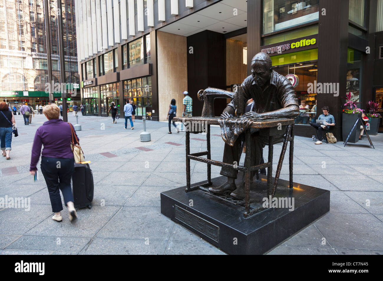 Manhattan New York City Garment District with huge statue of man stitching garments on treadle sewing machine - Stock Image