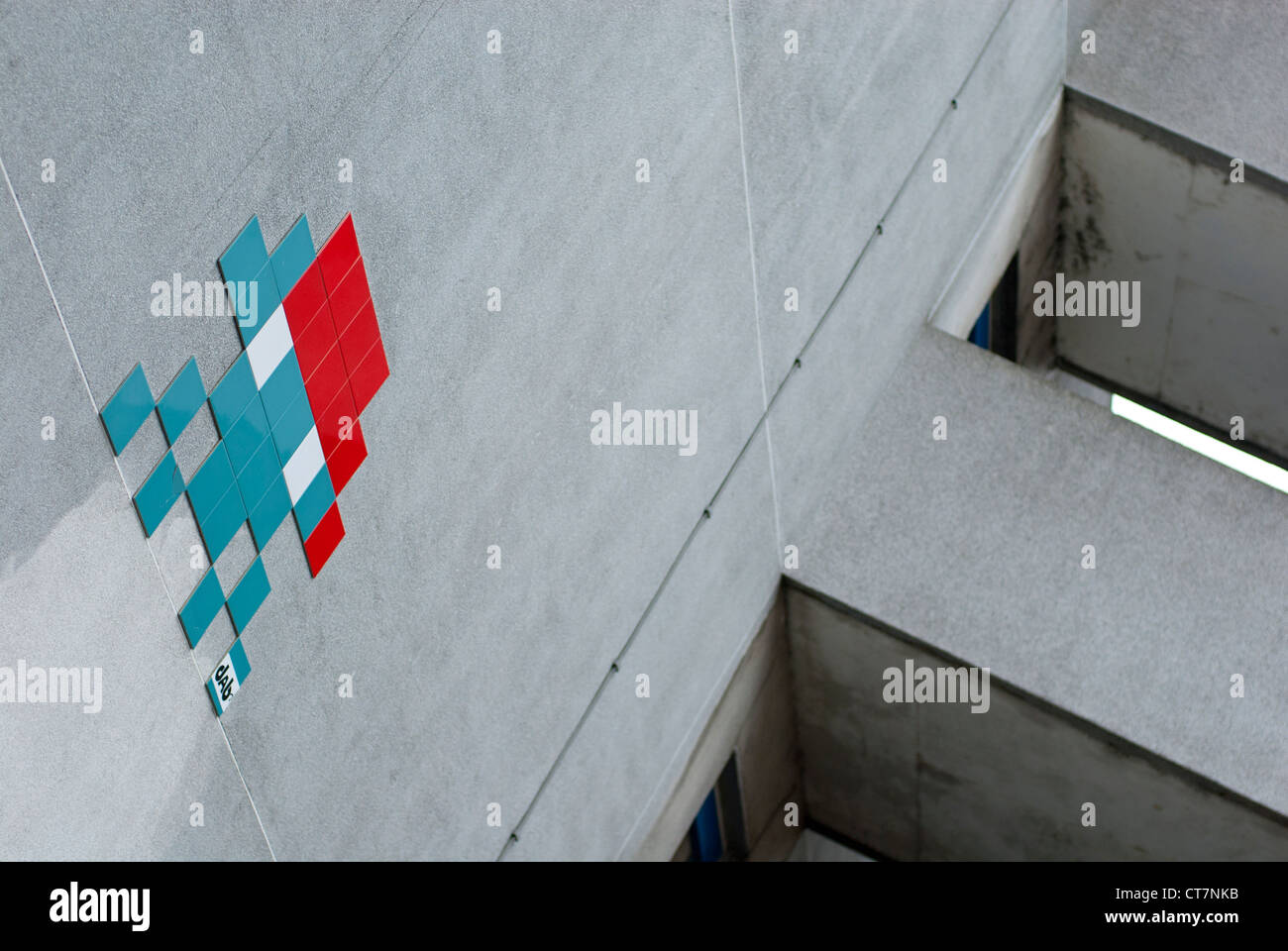 A different take on street graffiti using tiles to recreate a arcade space invader. - Stock Image