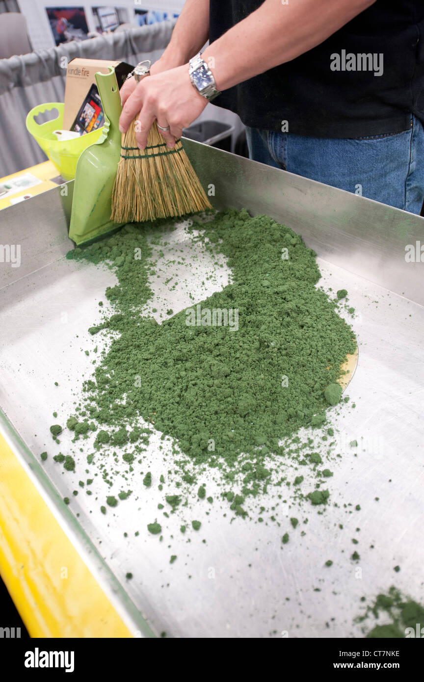 "Hazardous materials absorbent ""Green Stuff"" is used on sample oil and antifreeze at an environmental quality trade Stock Photo"