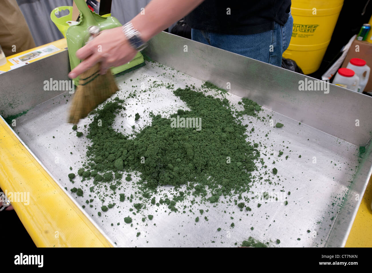 """Hazardous materials absorbent """"Green Stuff"""" is used on sample oil and antifreeze at an environmental quality trade Stock Photo"""