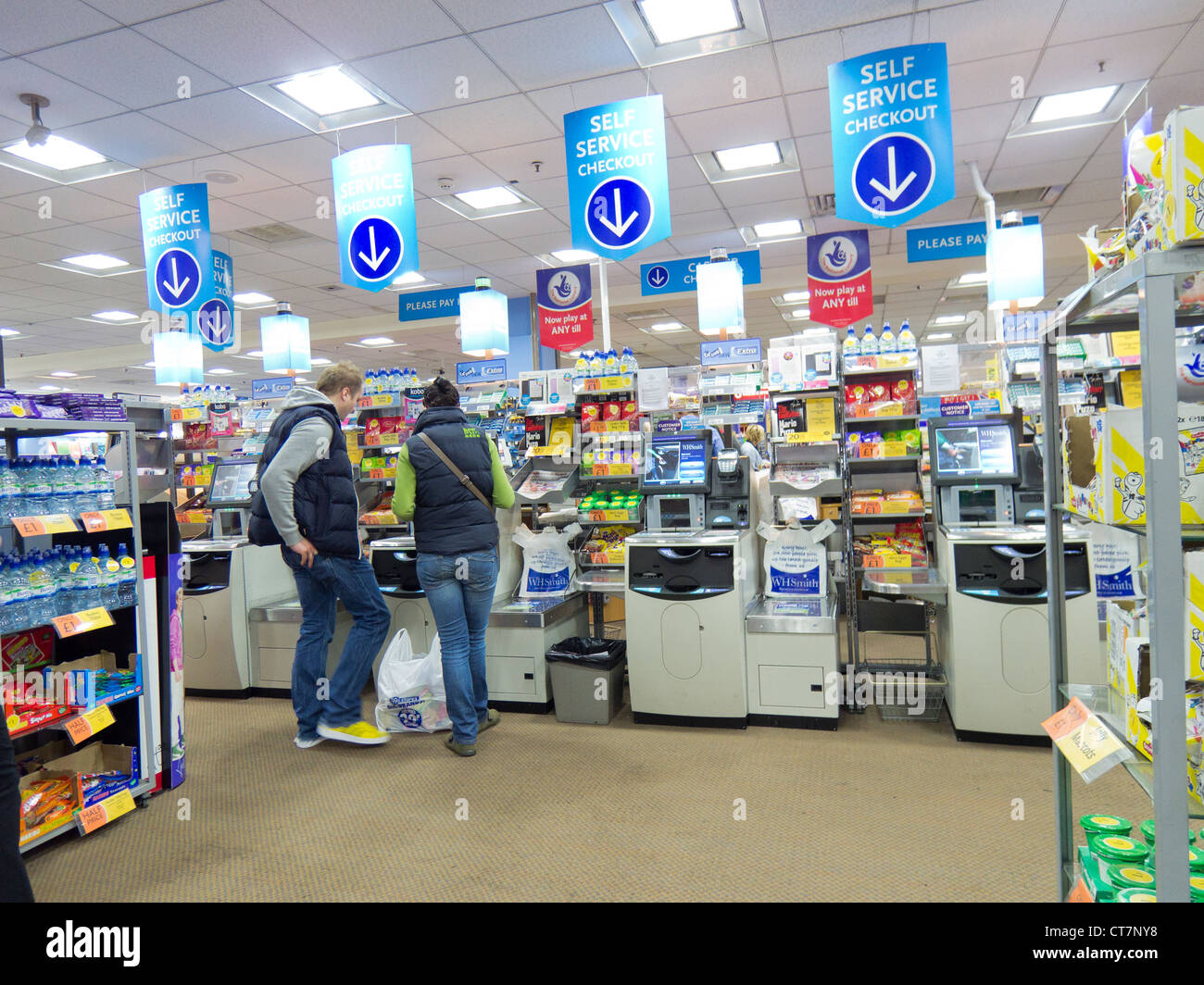 Self service checkouts in a WH Smith store - Stock Image