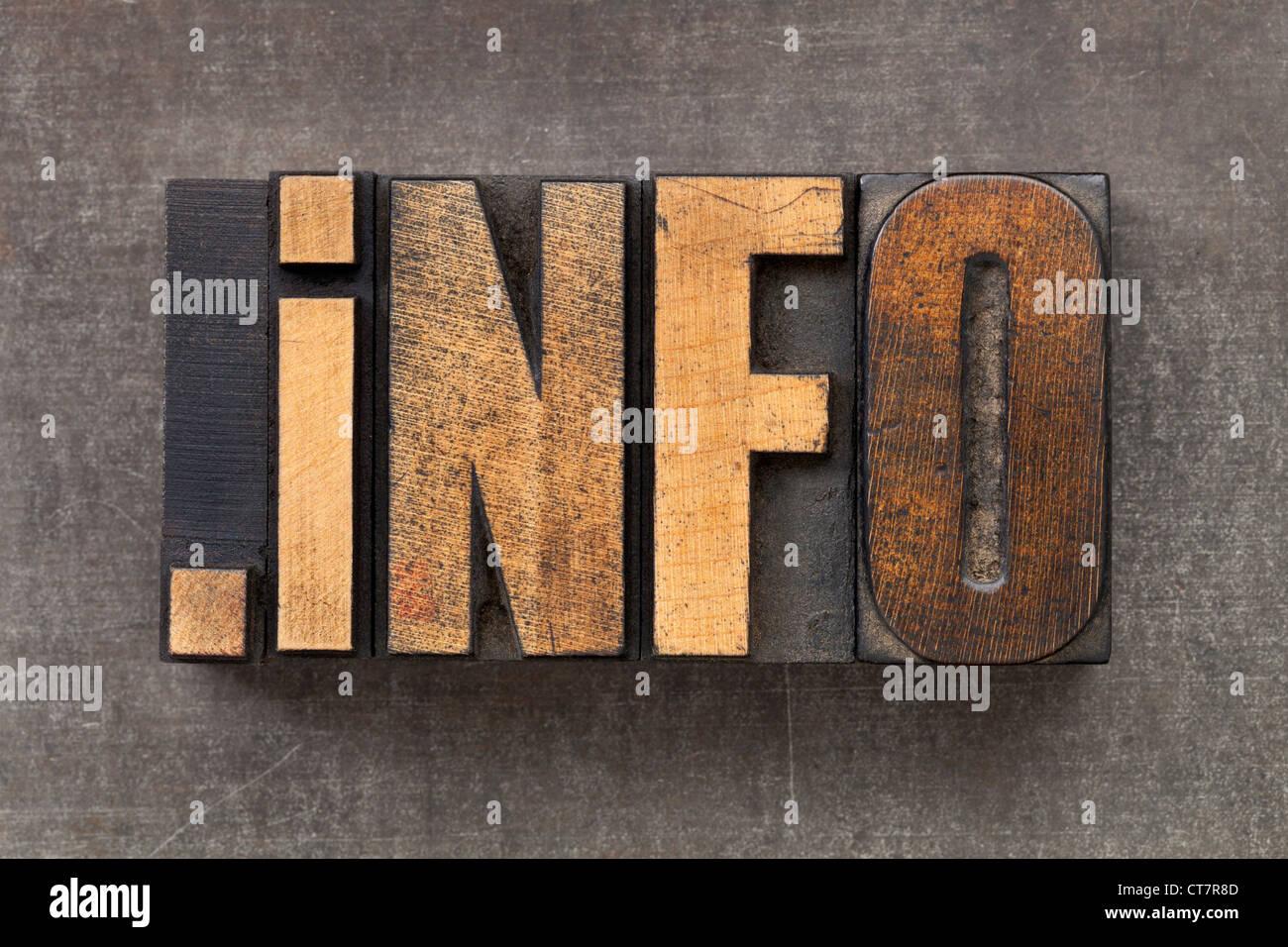 dot info - internet domain for information resources in vintage wooden letterpress printing blocks on a grunge metal - Stock Image