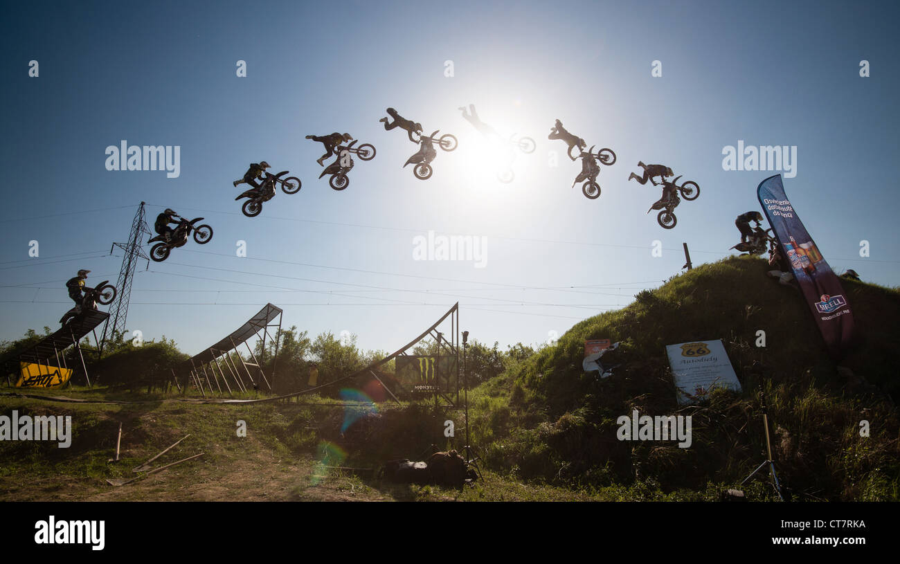 Jump sequence of Frantisek Maca (CZE) performing trick at FMX session on April 28, 2012 in Bratislava, Slovakia - Stock Image