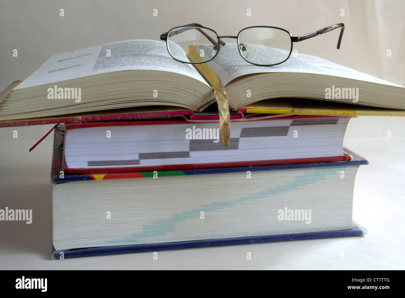 Books-Storehouse of Knowledge stalked for reference - Stock Image