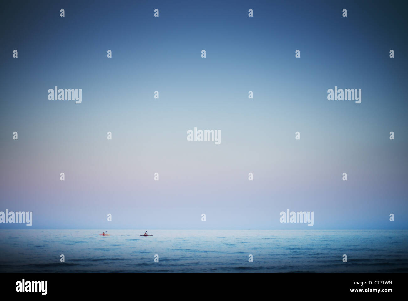 Kayaks in open water. - Stock Image