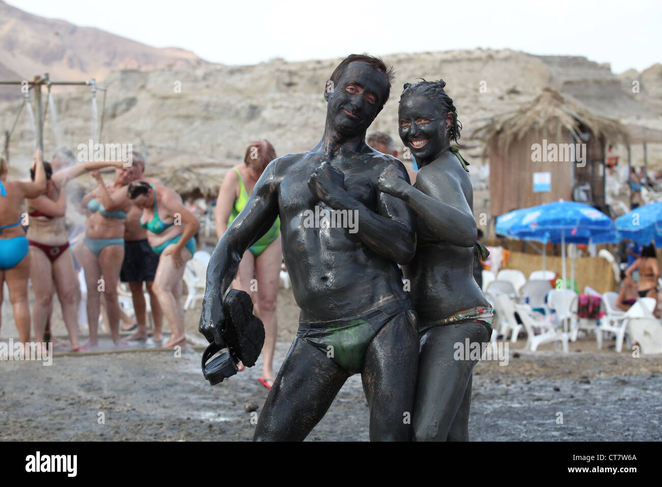 Israel, Dead Sea, tourists cover themselves in therapeutic mud - Stock Image