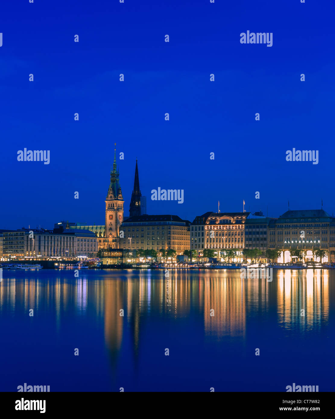 Hamburg skyline taken right after sunset at the blue hour over the binnen Alster. - Stock Image