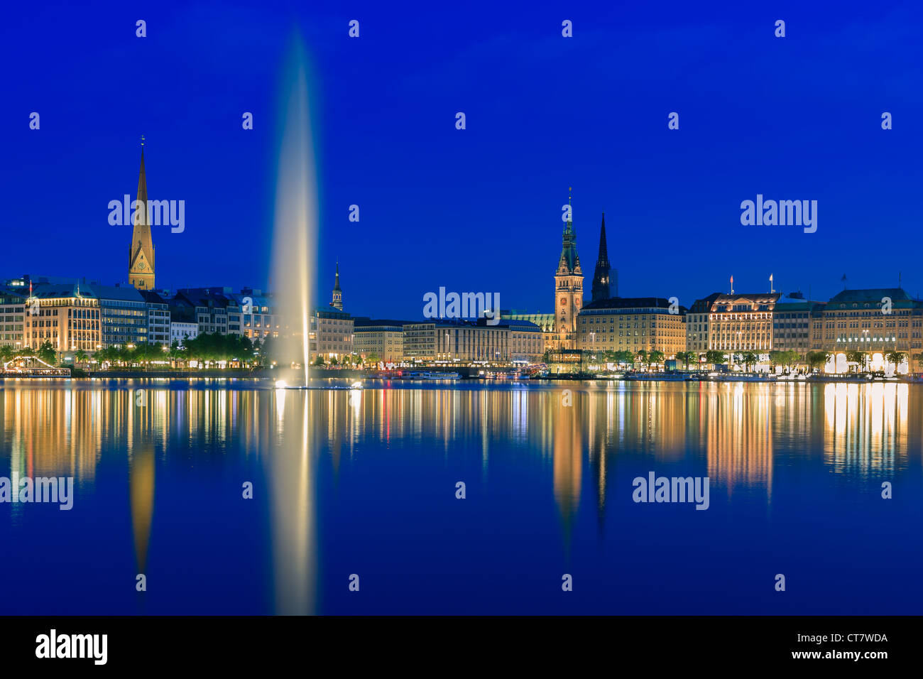 Hamburg skyline taken right after sunset at the blue hour over the binnenalster. Stock Photo