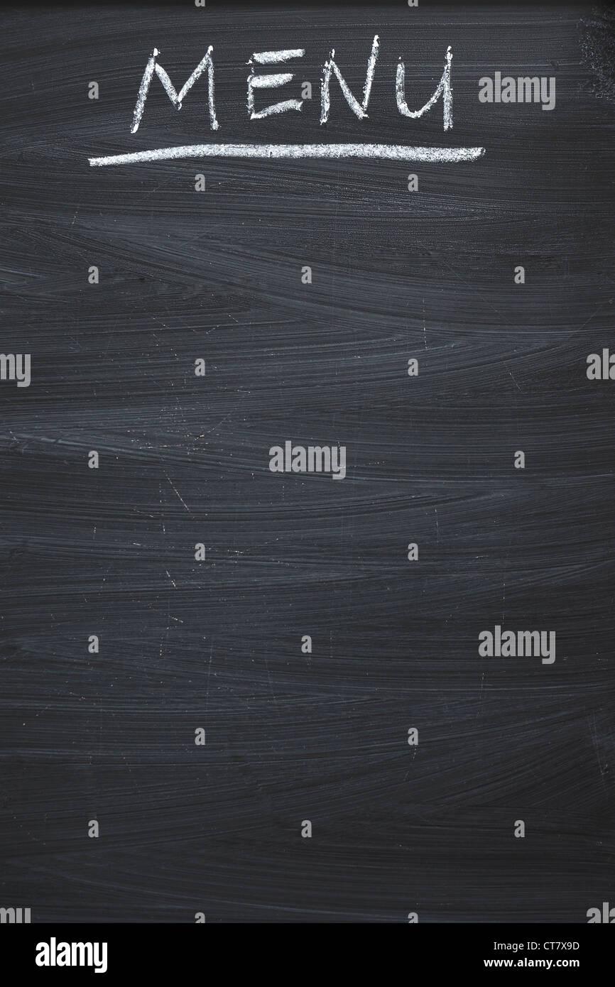 vertical black chalkboard with handwritten MENU word - Stock Image