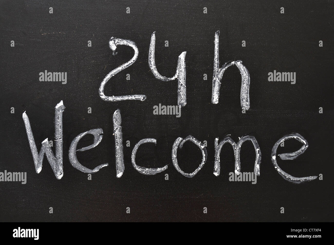 Handwritten 24 h Welcome sign on the blackboard - Stock Image