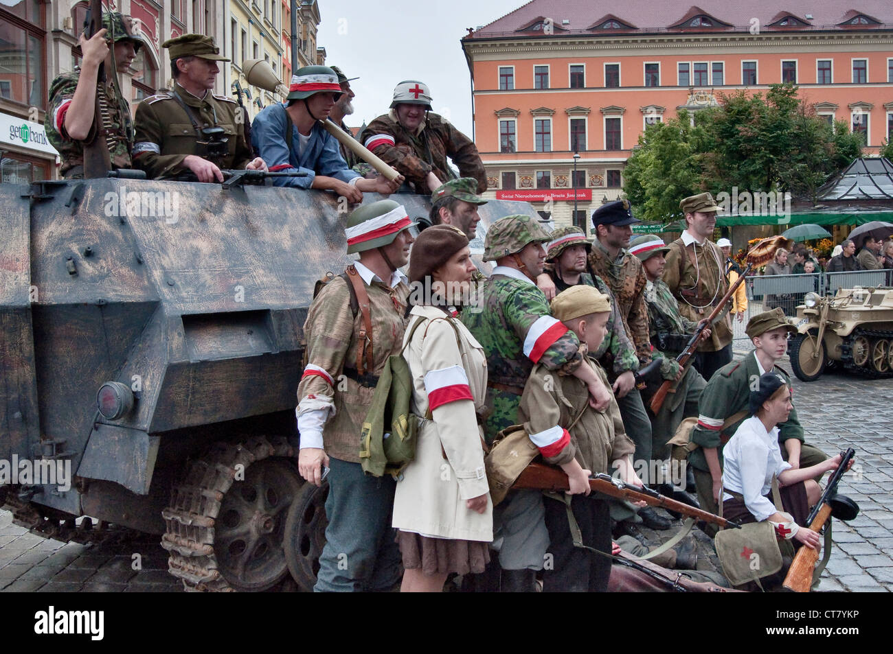 Home Army troops re-enactors posing for pictures after 1944 Warsaw Uprising re-enactment in Wroclaw, Poland - Stock Image