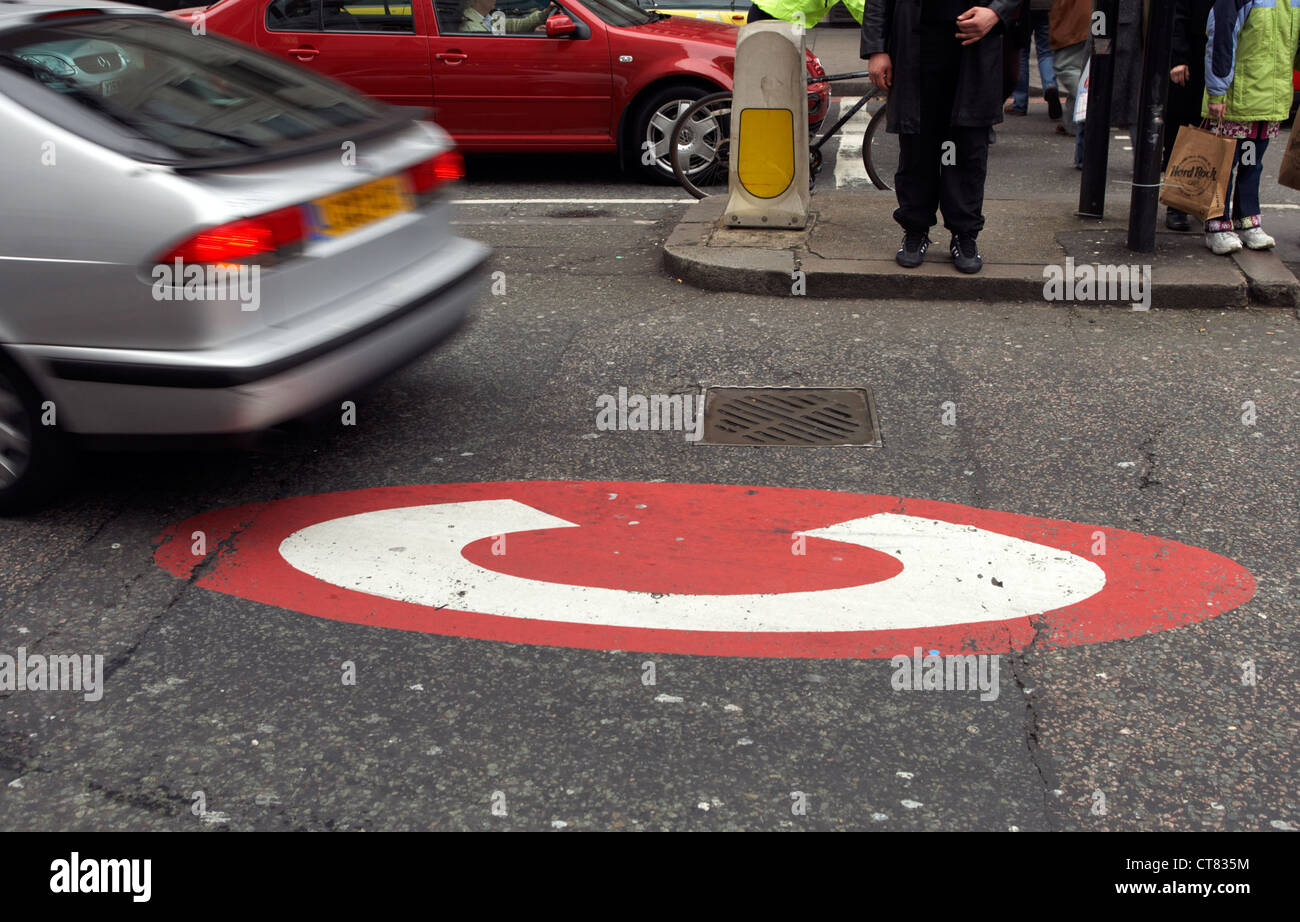 London - sign for the congestion charging on the road - Stock Image