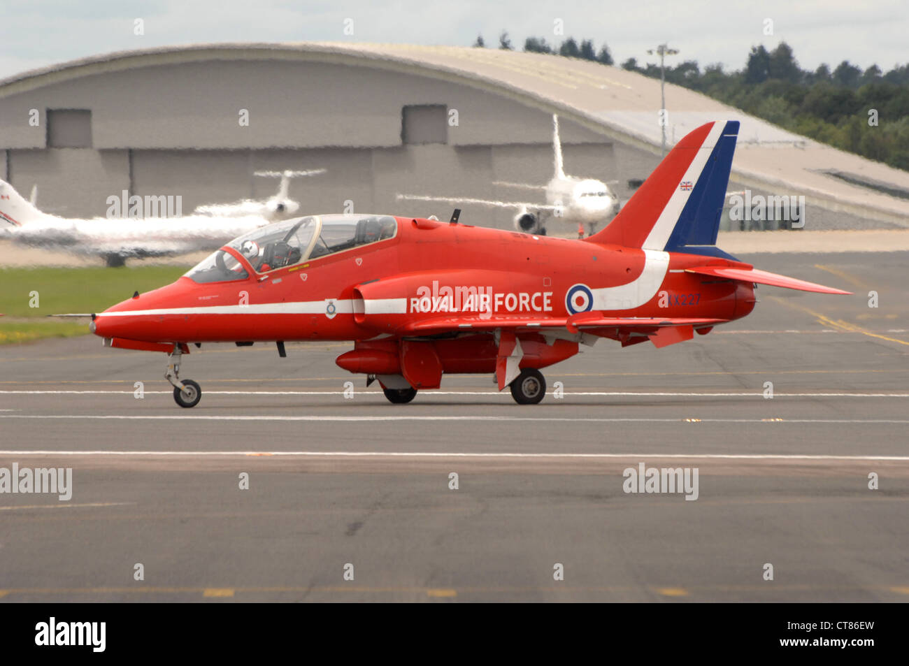 BAE Systems Hawk T1 of the RAF Red Arrows display team taxiing on the runway at Farnborough. England. - Stock Image