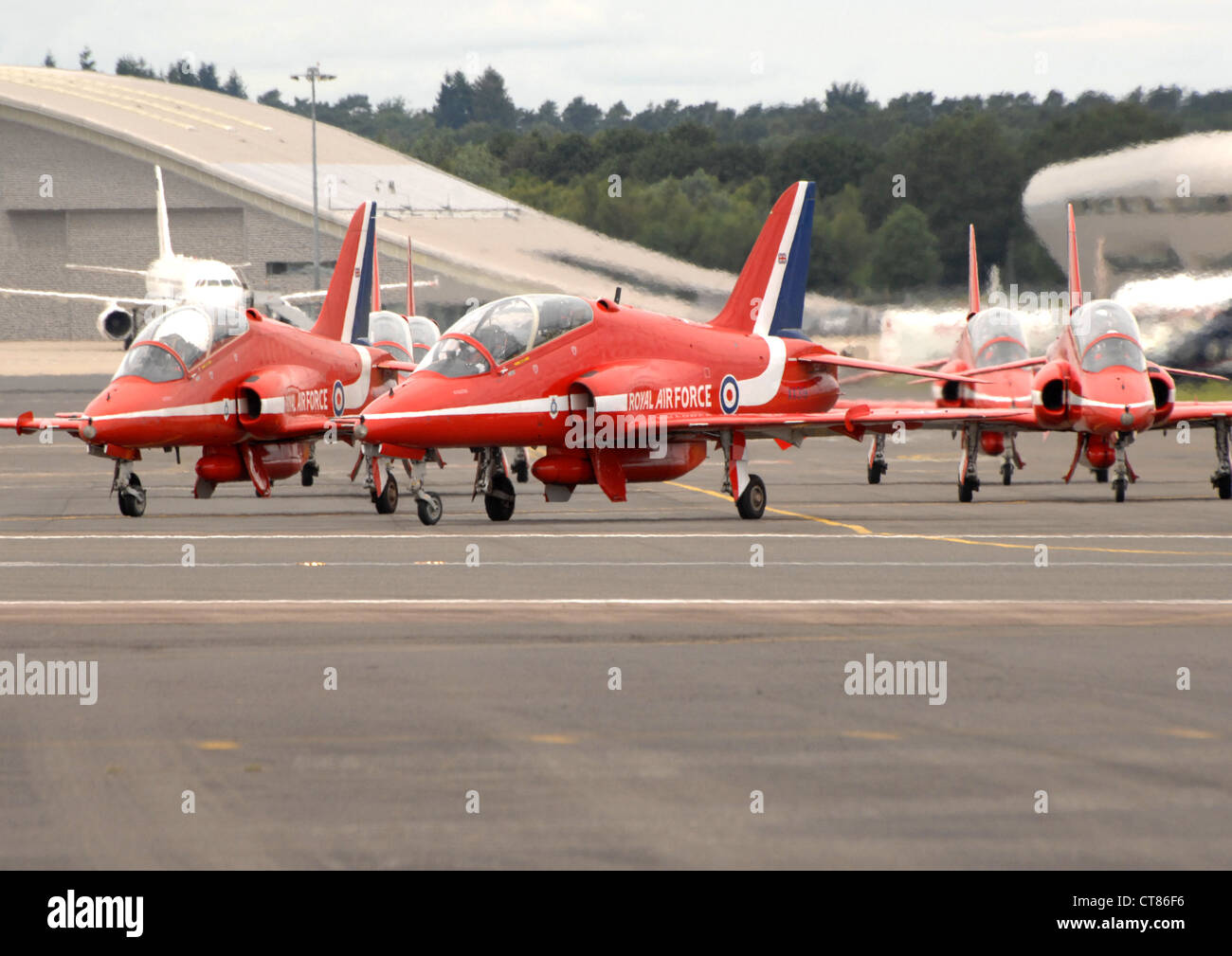 BAE Systems Hawk T1s of the RAF Red Arrows display team taxiing on the runway at Farnborough. England. - Stock Image