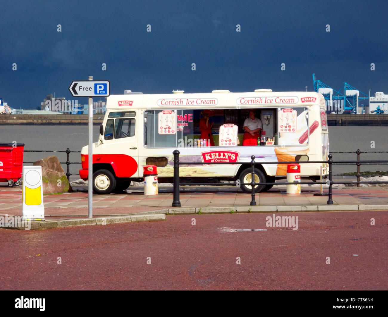 New Brighton, end of season. Sept 2011. Merseyside seaside resort.  Ice cream van parked by River Mersey, industry - Stock Image