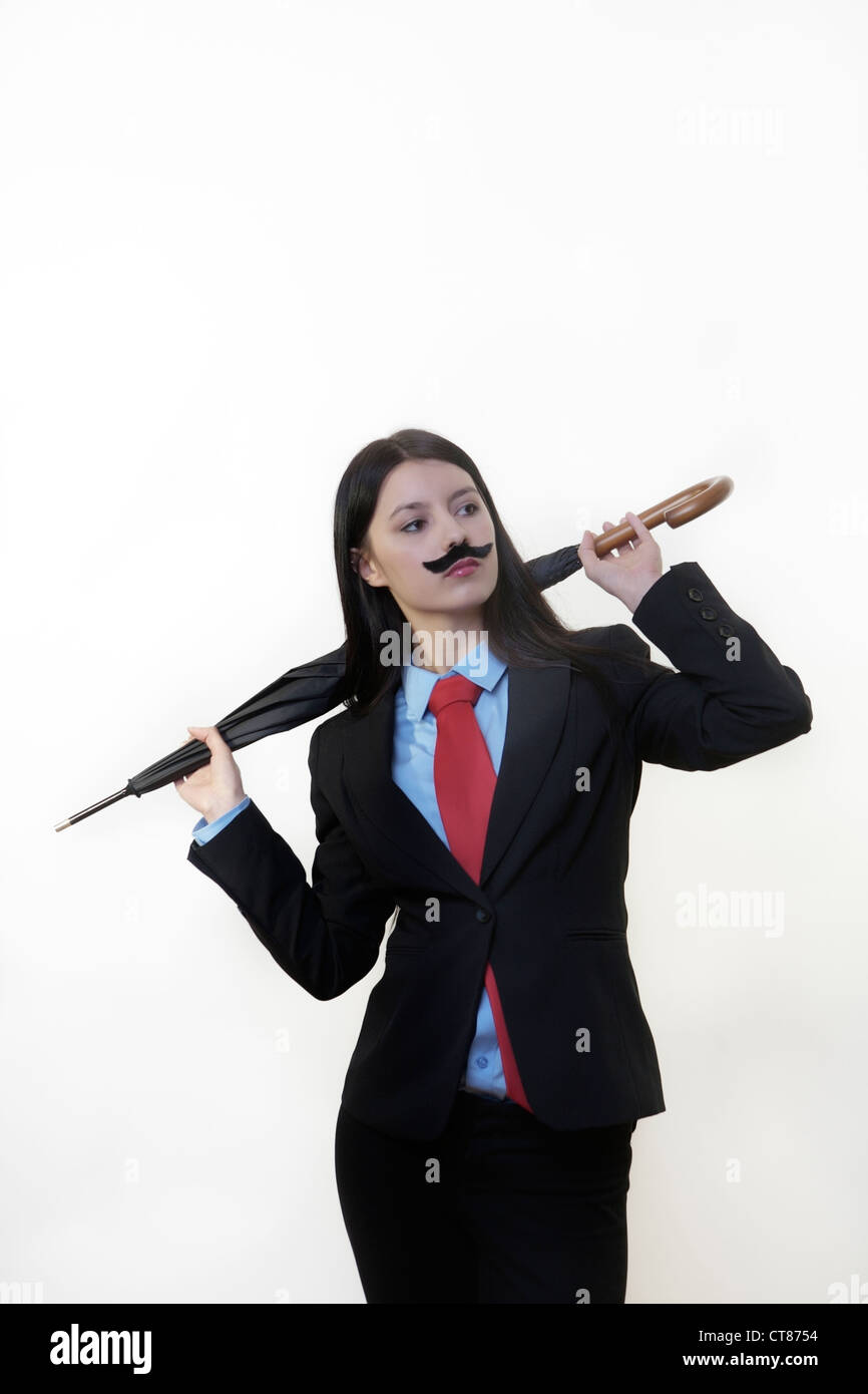 Young Woman Dressed Up In A Man S Suit And Tie Wearing A Fake Stock