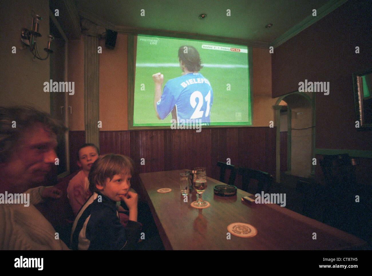Premiere conference call the Bundesliga in pub - Stock Image