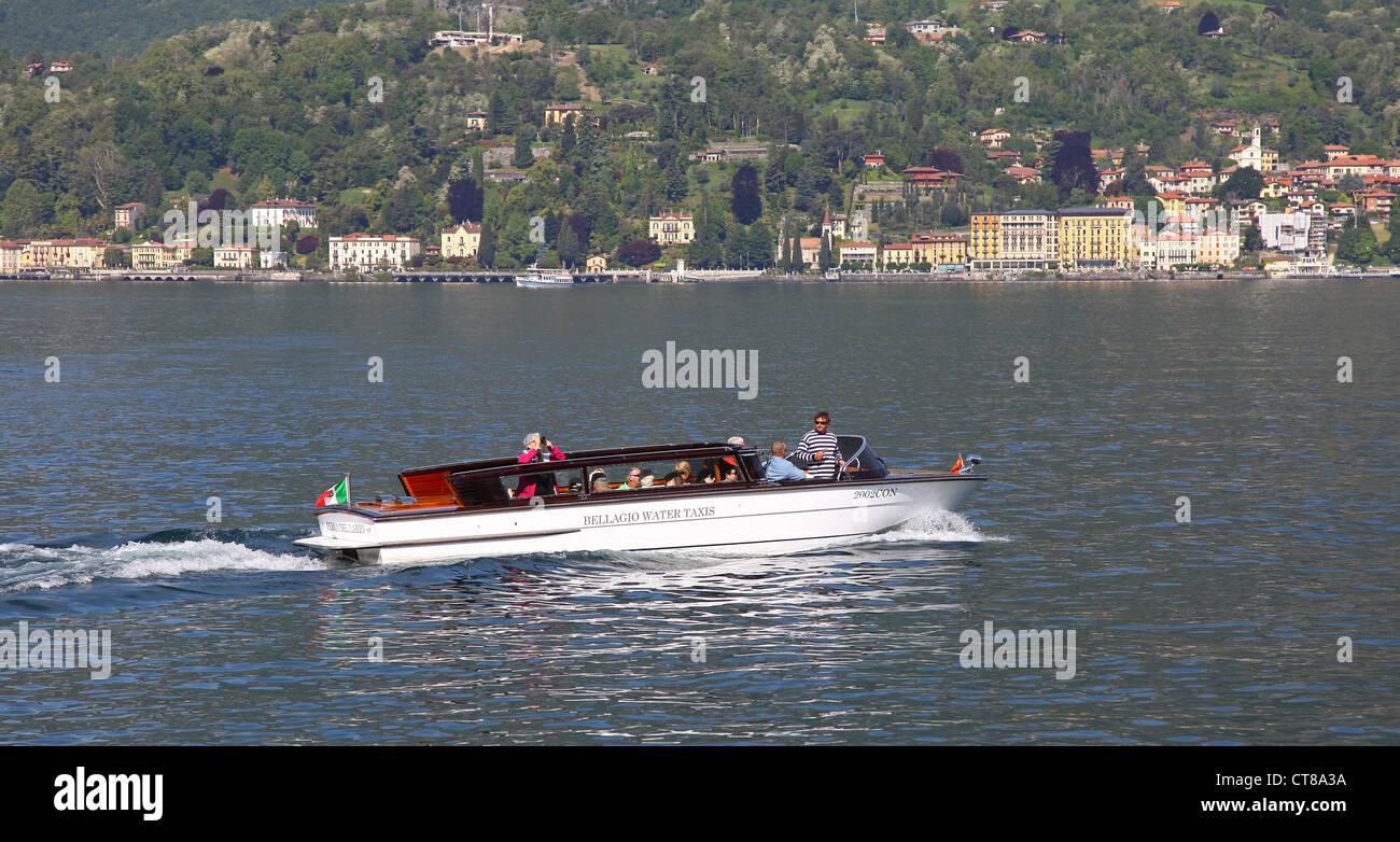 a water taxi in bellagio on lake como italian lakes italy stock