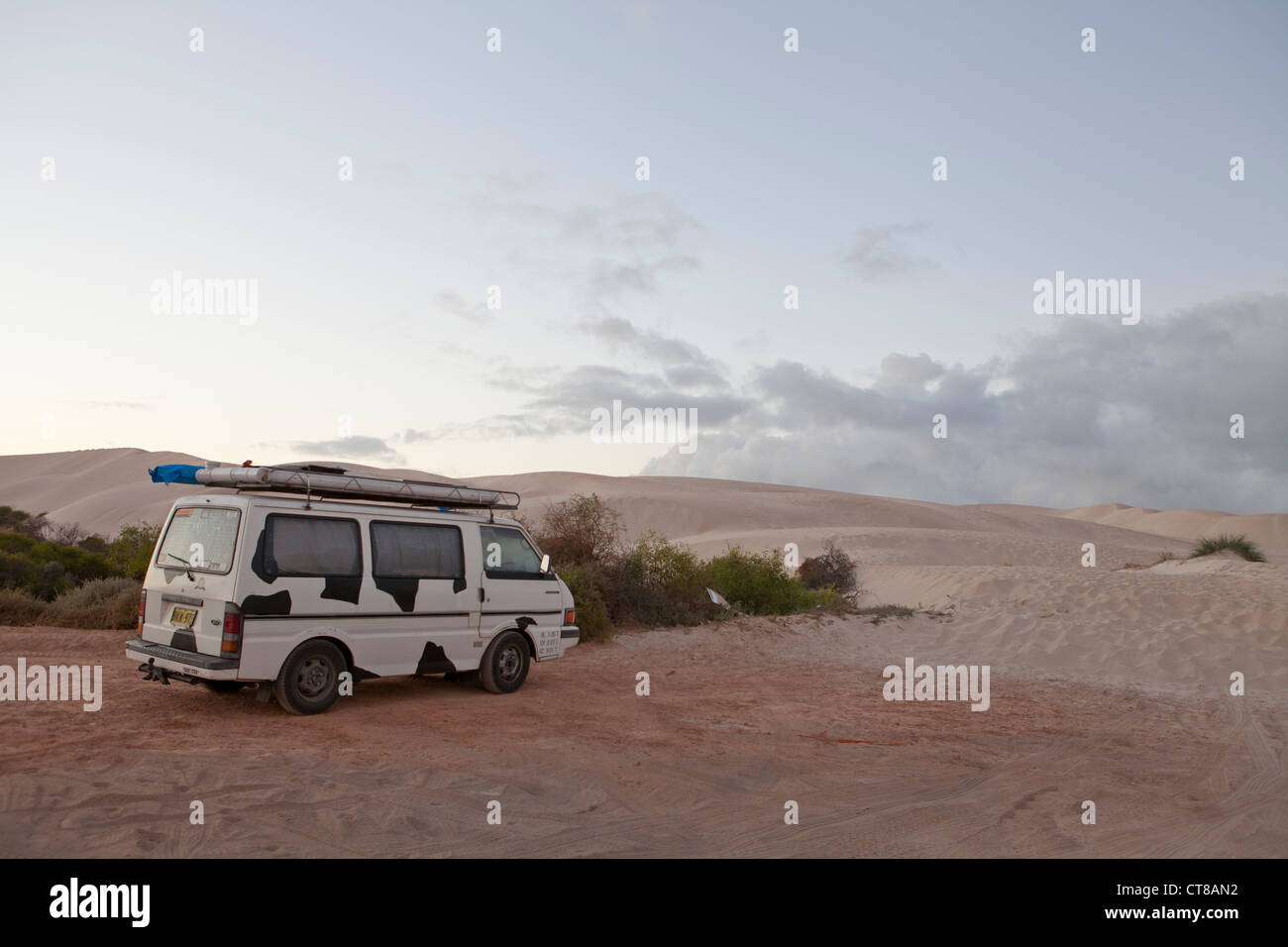 Campervan the morning after spending the night in a beach car park in Geraldton, Western Australia - Stock Image