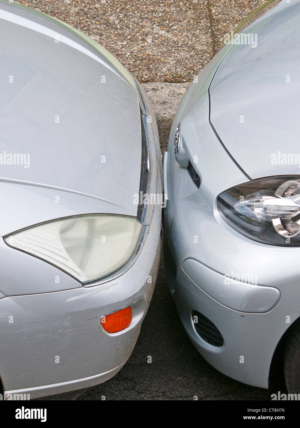 Two cars badly parked bumper to bumper - France. - Stock Image
