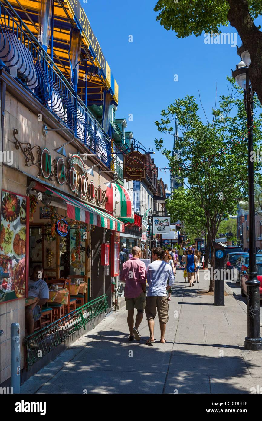 Bars, Cafes and Restaurants along Rue Saint-Denis in the Quartier Latin (Latin Quarter), Montreal, Quebec, Canada - Stock Image