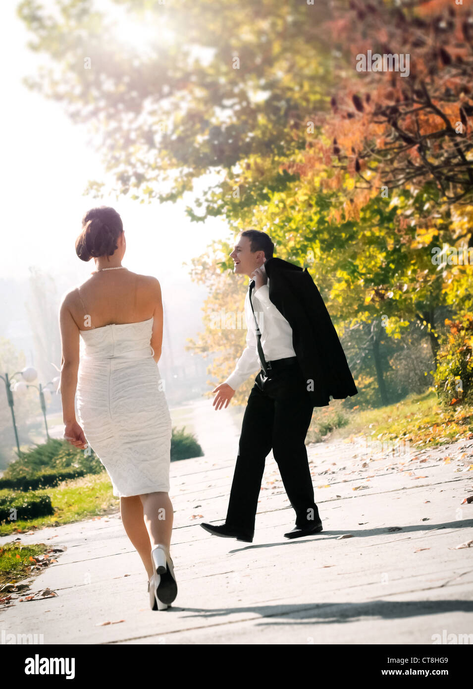 Young man Impressing a woman - Stock Image