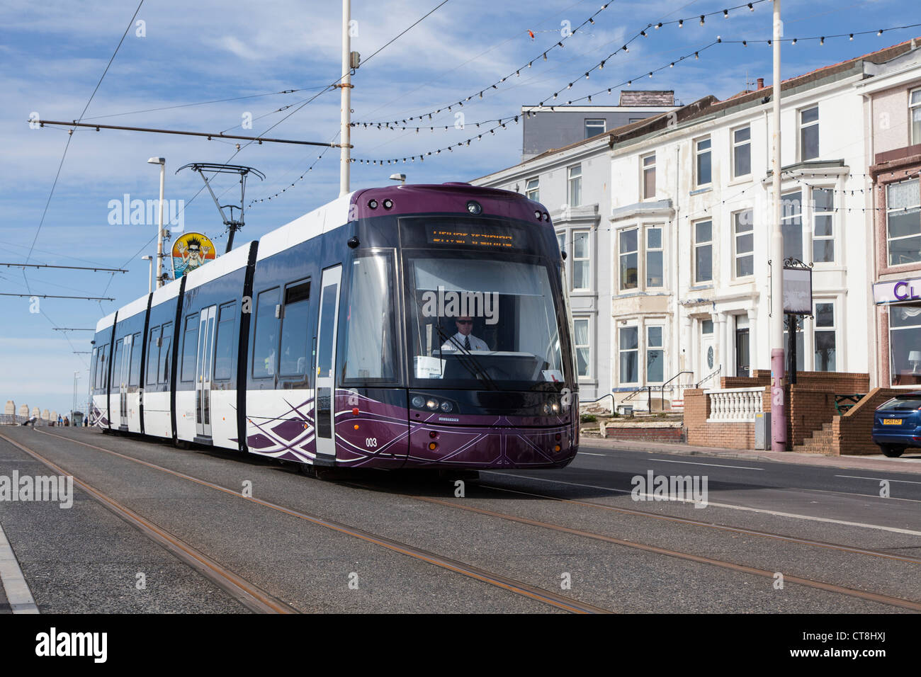 Blackpool Bombardier tram passing bed and breakfast establishments a few months after entering service in April - Stock Image