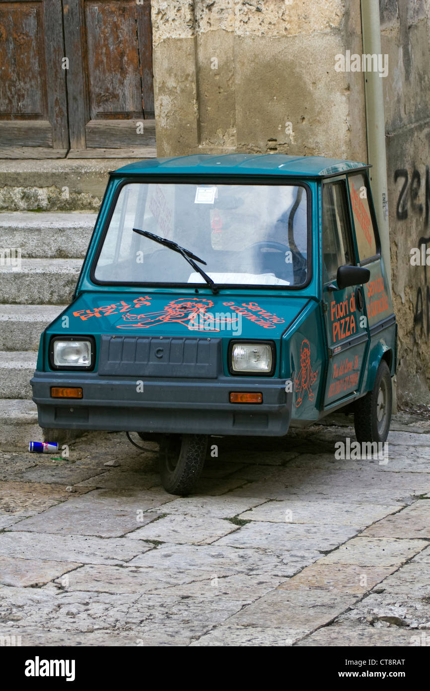 Small ape-car used for pizza delivery in Matera - Stock Image
