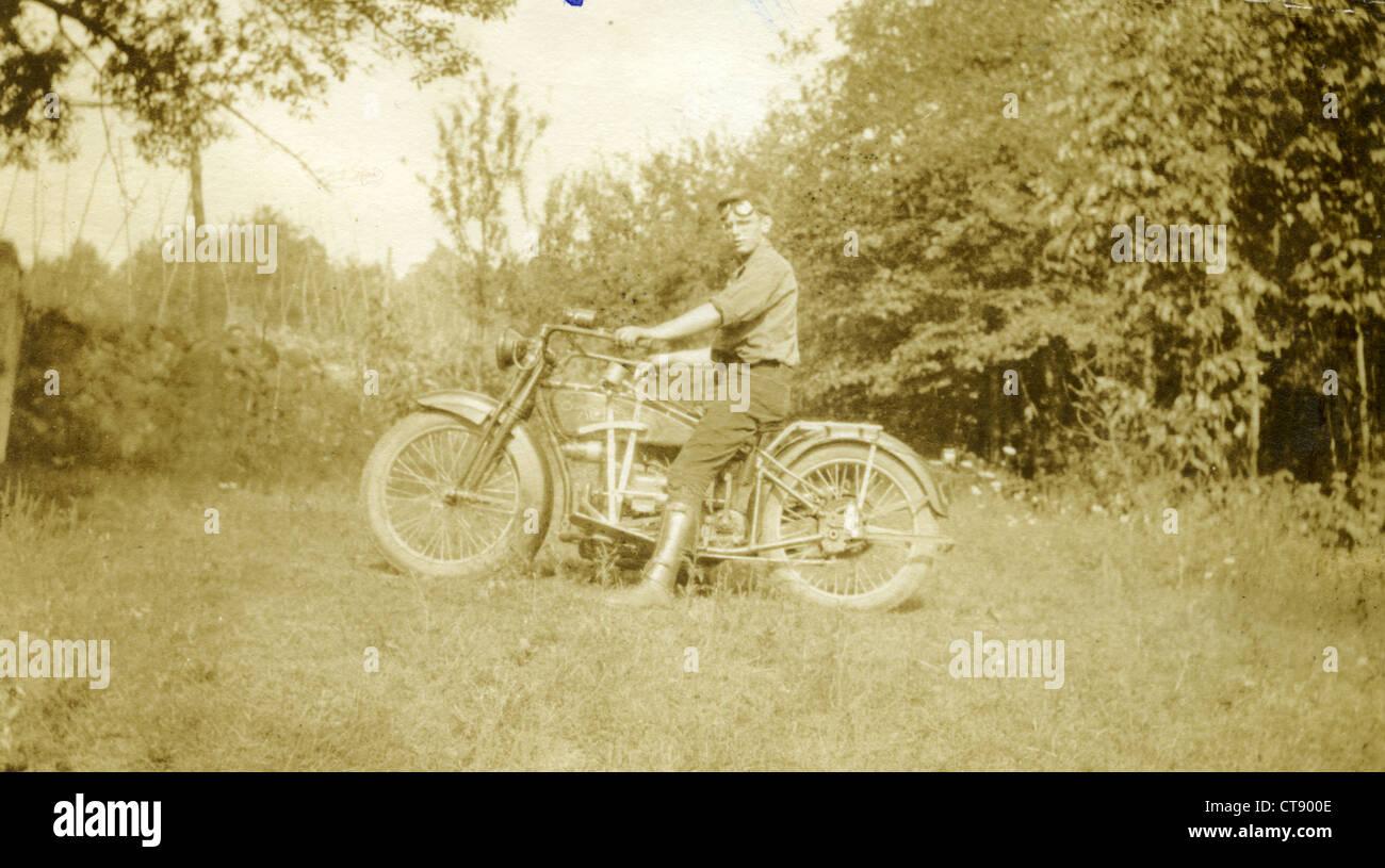 Military man on 1921 motorcycle. 1920s veteran portrait - Stock Image