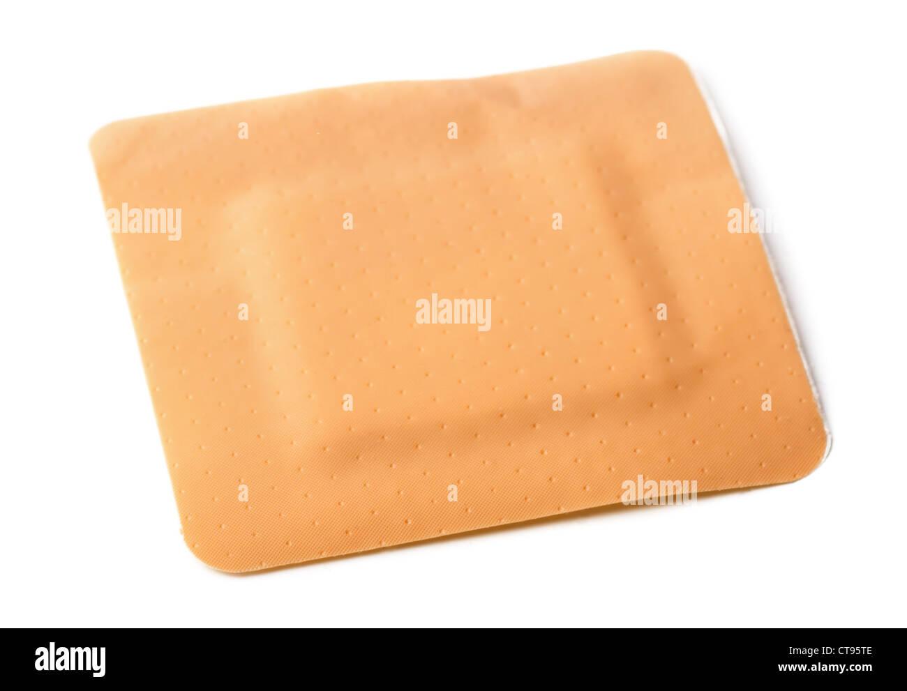 Square adhesive bandage isolated on white - Stock Image