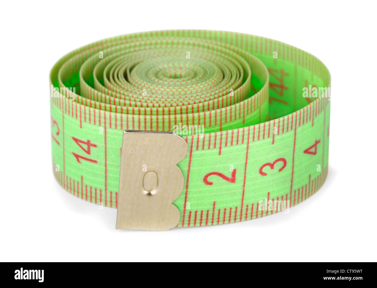 Green rolled tape measure isolated on white - Stock Image