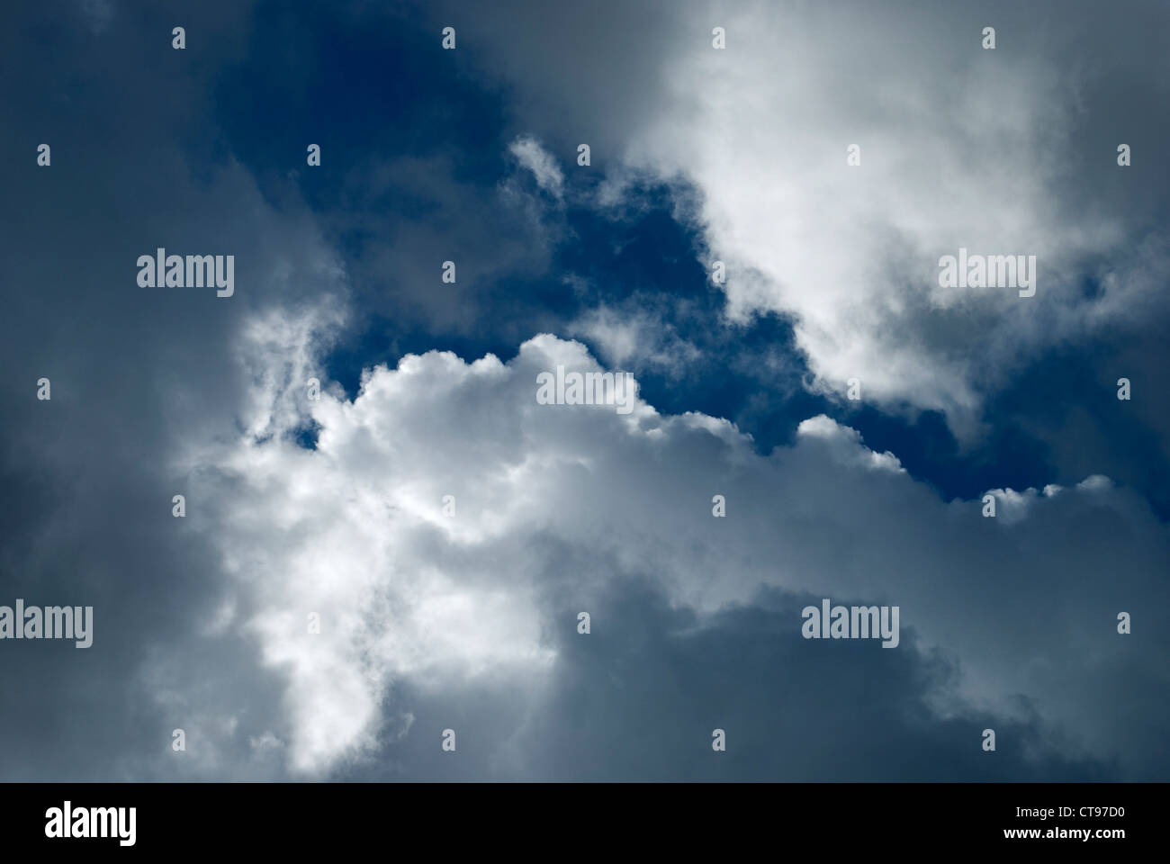 stratus clouds drifting across the sky on a bright day Stock Photo