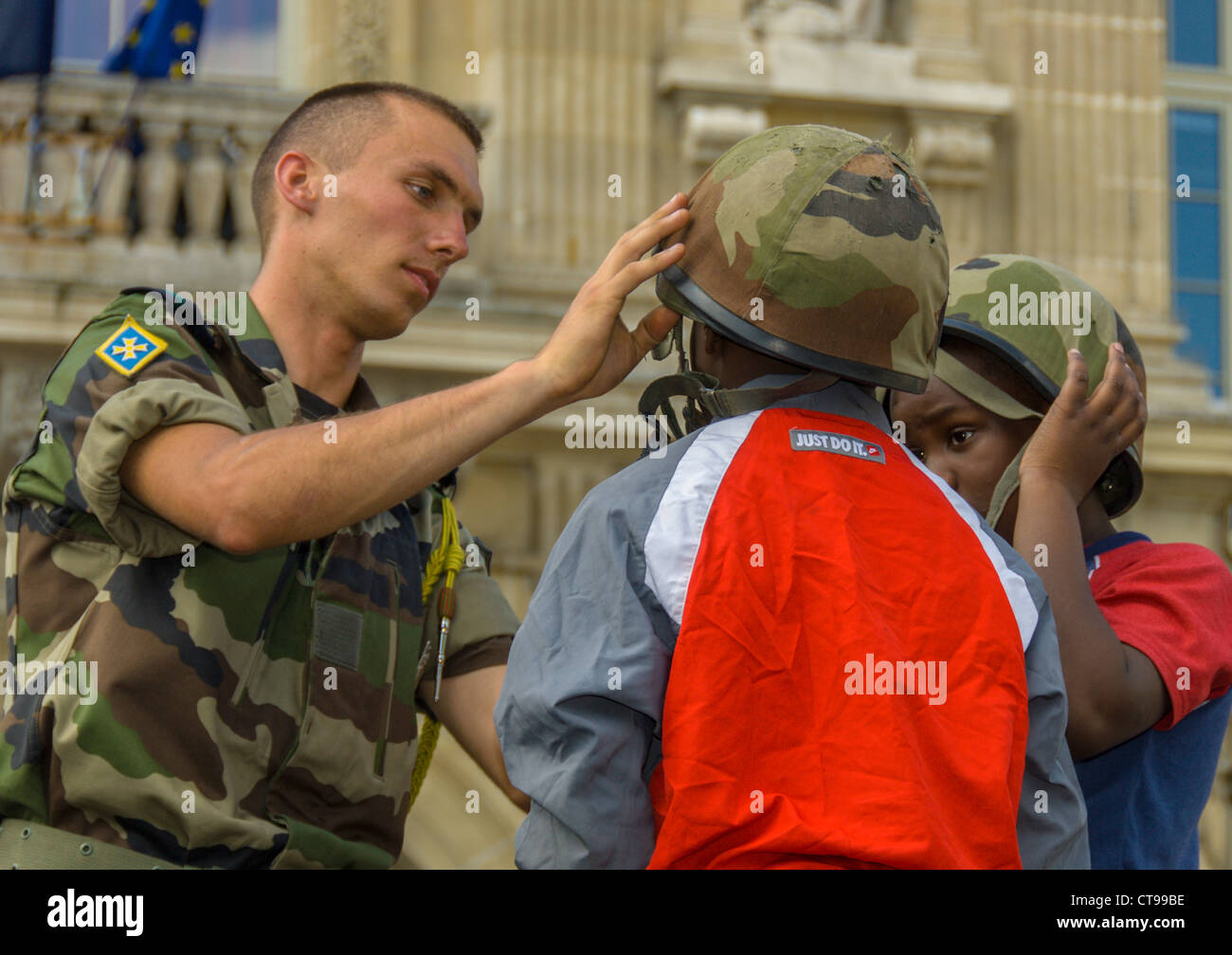 """Public Events, National Day, """"Bastille Day"""", 14th of July, Children Military on Public Square, Young Boys Trying Stock Photo"""
