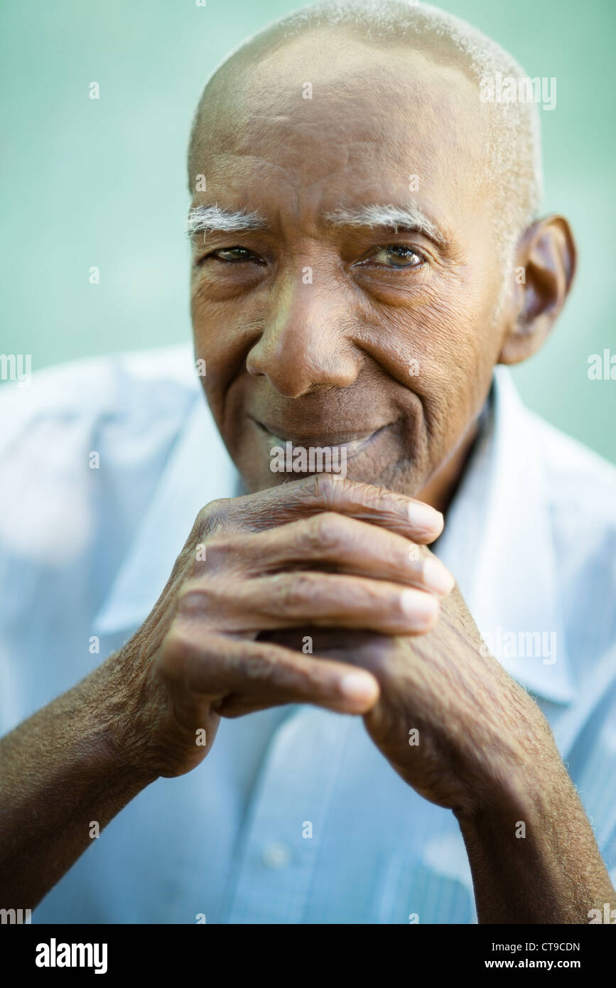 Portrait of happy senior hispanic man looking at camera and smiling - Stock Image