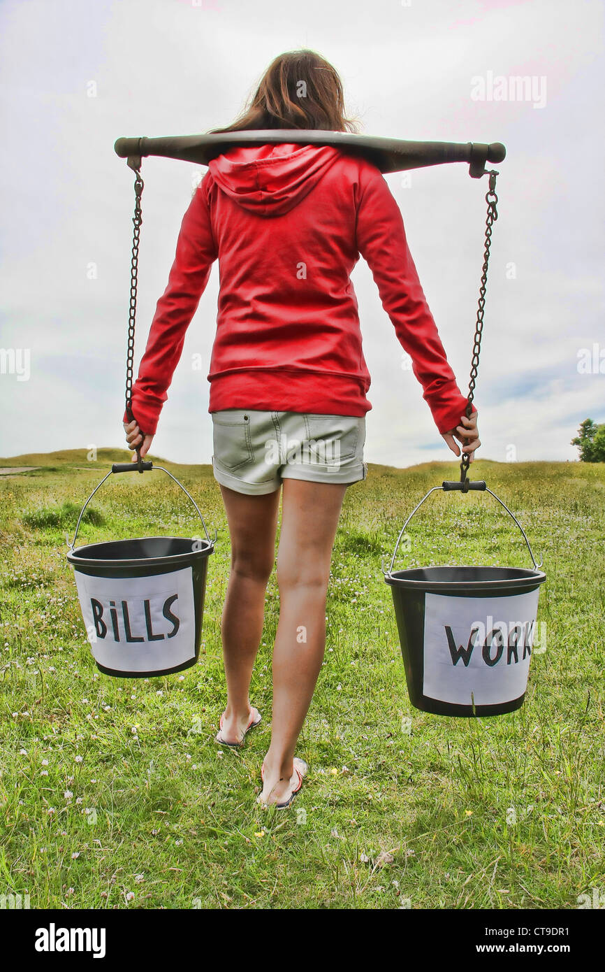 Young woman with buckets - Stock Image