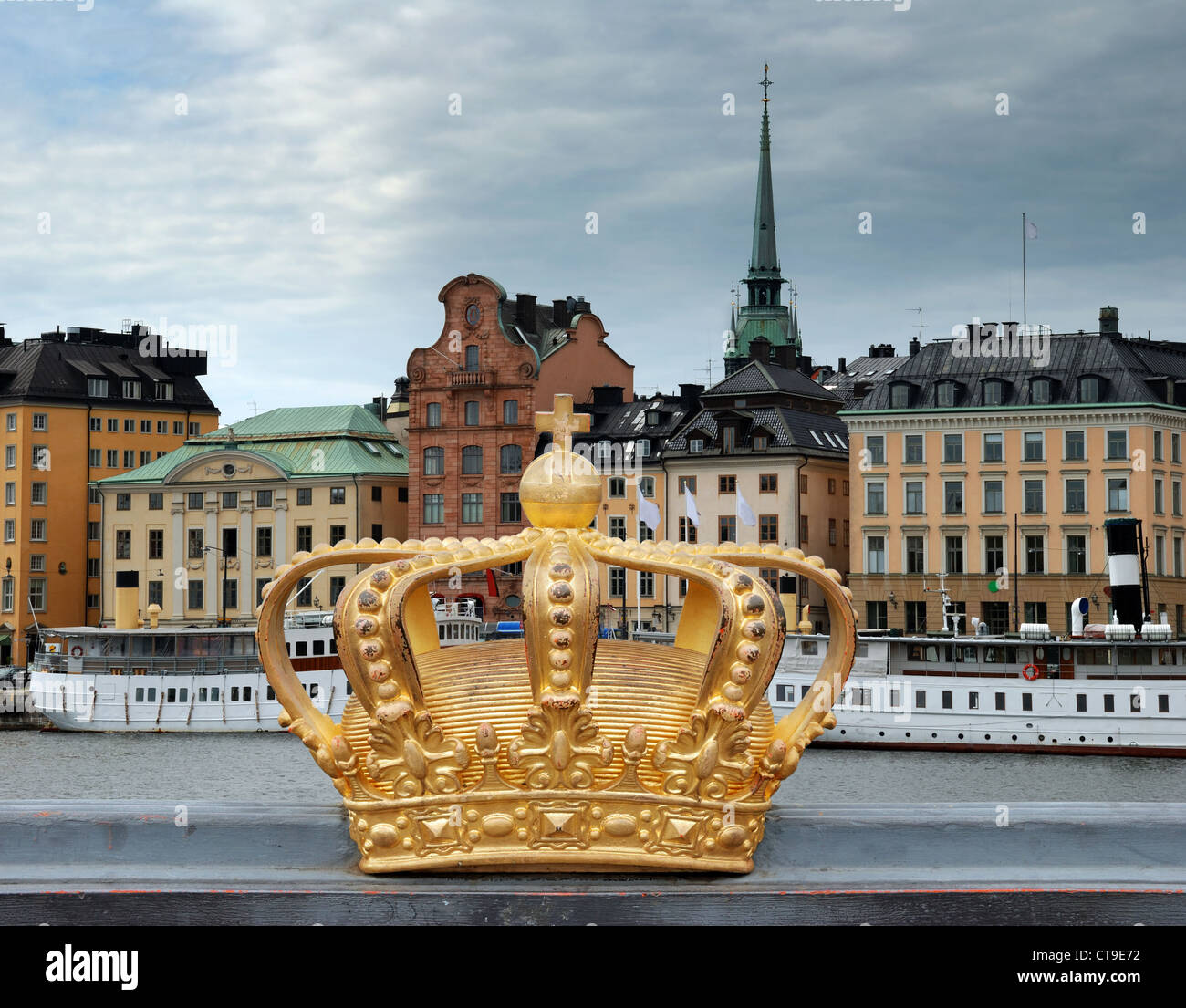 Golden crown on Skeppsholmen bridge in Stockholm, Sweden. - Stock Image